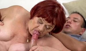 Redhead grandma gives head before impassioned banging